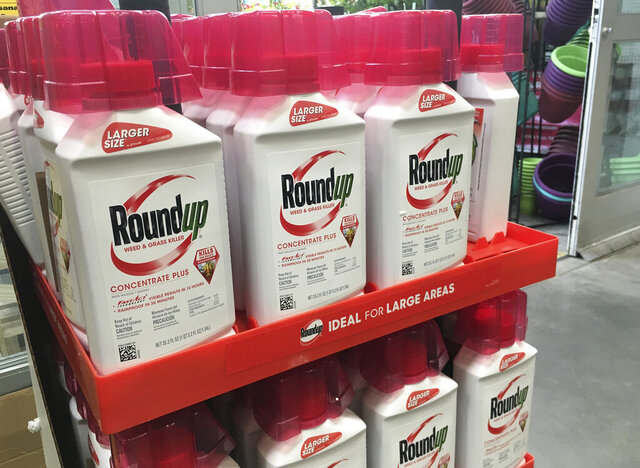FILE - In this, Feb. 24, 2019, file photo, containers of Roundup are displayed at a store in San Francisco. German pharmaceutical company Bayer announced Wednesday, June 24, 2020, it's paying up to $10.9 billion to settle a lawsuit over subsidiary Monsanto's weedkiller Roundup, which has faced numerous lawsuits over claims it causes cancer.  (AP Photo/Haven Daley, File)