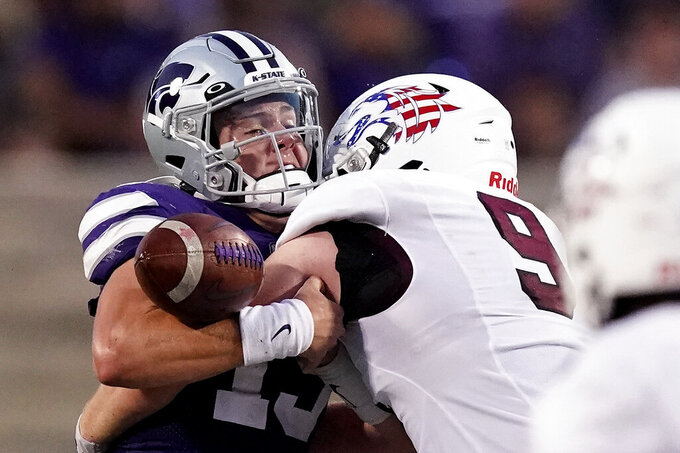 Kansas State quarterback Will Howard (15) fumbles the ball as he is sacked by Southern Illinois running back Pop Jones III (9) during the first half of an NCAA college football game, Saturday, Sept. 11, 2021, in Manhattan, Kan. (AP Photo/Charlie Riedel)