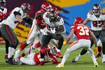Kansas City Chiefs free safety Daniel Sorensen grabs the leg of Tampa Bay Buccaneers running back Leonard Fournette during the first half of the NFL Super Bowl 55 football game Sunday, Feb. 7, 2021, in Tampa, Fla. (AP Photo/Mark Humphrey)