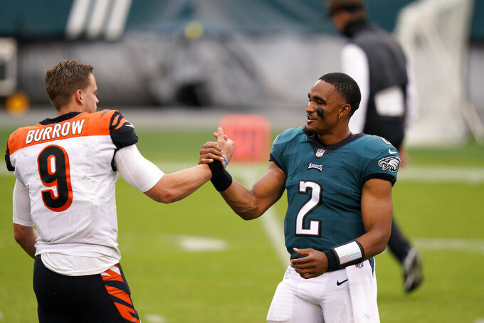 Cincinnati Bengals' Joe Burrow, left, meets with Philadelphia Eagles' Jalen Hurts after an NFL football game, Sunday, Sept. 27, 2020, in Philadelphia. (AP Photo/Chris Szagola)