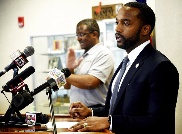 This April 3, 2020 photo shows Shreveport Mayor Adrian Perkins during a news conference regarding the coronavirus in Shreveport, La.  Perkins is entering Louisiana's U.S. Senate race. He announced Wednesday that he's trying to unseat Republican incumbent Bill Cassidy in a last-minute entrance into the competition as the candidate signup period begins.  (Henrietta Wildsmith/The Shreveport Times via AP)