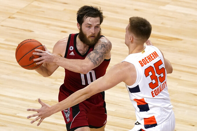 Syracuse guard Buddy Boeheim (35) guards North Carolina State guard Braxton Beverly (10) during the first half of an NCAA college basketball game in the second round of the Atlantic Coast Conference tournament in Greensboro, N.C., Wednesday, March 10, 2021. (AP Photo/Gerry Broome)