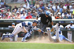 Kansas City Royals' Nicky Lopez slides safety to home base against Minnesota Twins' Jason Castro during the seventh inning of a baseball game Sunday, June 16, 2019, in Minneapolis. Lopez scored after teammate Billy Hamilton hit a sacrifice bunt. (AP Photo/Stacy Bengs)