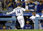 Los Angeles Dodgers' Enrique Hernandez (14) celebrates his two-run home run with manager Dave Roberts during the fourth inning of the team's baseball game against the Arizona Diamondbacks Tuesday, July 2, 2019, in Los Angeles. (AP Photo/Marcio Jose Sanchez)