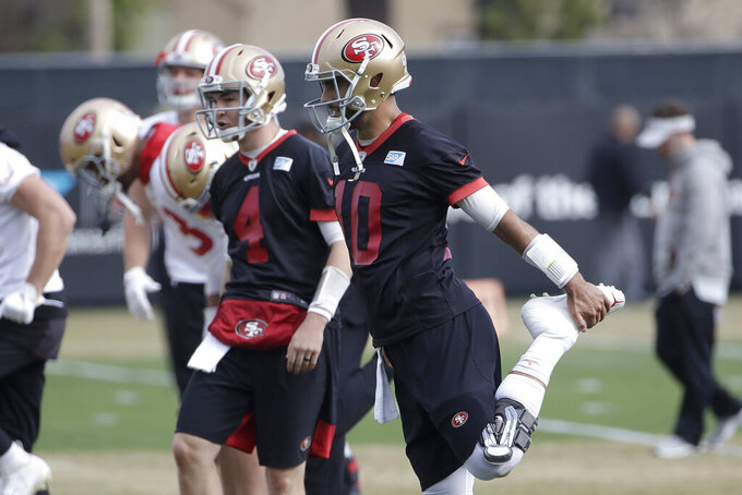 San Francisco 49ers quarterback Jimmy Garoppolo (10) stretches during practice at the team's NFL football training facility in Santa Clara, Calif., Thursday, Jan. 23, 2020. The 49ers will face the Kansas City Chiefs in Super Bowl 54. (AP Photo/Jeff Chiu)