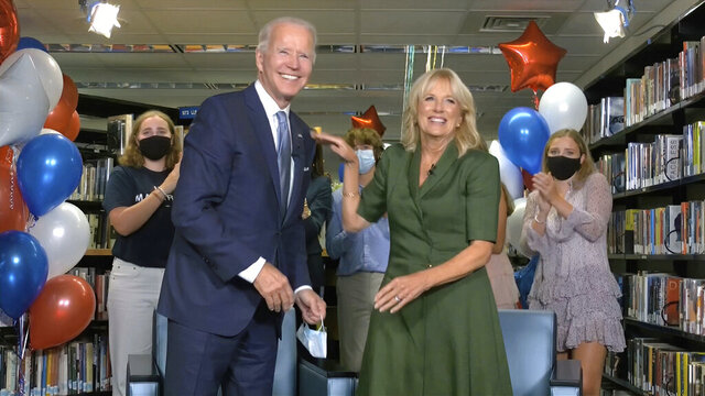 In this image from video, Democratic presidential candidate former Vice President Joe Biden, his wife Jill Biden, and members of the Biden family, celebrate after the roll call vote during the second night of the Democratic National Convention on Tuesday, Aug. 18, 2020. (Democratic National Convention via AP)