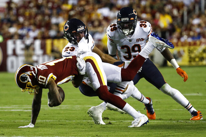 Washington Redskins wide receiver Paul Richardson (10) is tackled by Chicago Bears cornerback Kyle Fuller (23) and safety Eddie Jackson (39) during the first half of an NFL football game Monday, Sept. 23, 2019, in Landover, Md. (AP Photo/Patrick Semansky)