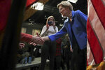 Democratic presidential candidate Sen. Elizabeth Warren, D-Mass., meets supporters after her address at the New Hampshire Institute of Politics in Manchester, N.H., Thursday, Dec. 12, 2019.(AP Photo/Charles Krupa)