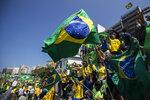 Supporters gather during a demonstration backing Brazil's President Jair Bolsonaro, marking Independence Day on Copacabana Beach in Rio de Janeiro, Brazil, Tuesday, Sept. 7, 2021. (AP Photo/Bruna Prado)