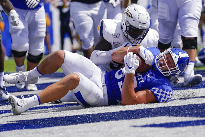 Kentucky tight end Justin Rigg (83) recovers a fumble for a touchdown during the first half of the NCAA college football game against Toledo, Saturday, Aug. 31, 2019, in Lexington, Ky. (AP Photo/Bryan Woolston)