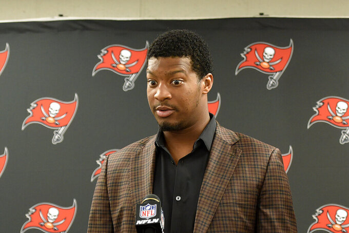 Tampa Bay Buccaneers quarterback Jameis Winston talks with reporters following the team's preseason NFL football game against the Pittsburgh Steelers in Pittsburgh, Friday, Aug. 9, 2019. The Steelers won 30-28. (AP Photo/Don Wright)