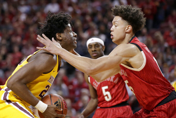 Nebraska's Isaiah Roby, right, defends Minnesota's Daniel Oturu (25) during the first half of an NCAA college basketball game in Lincoln, Neb., Wednesday, Feb. 13, 2019. (AP Photo/Nati Harnik)