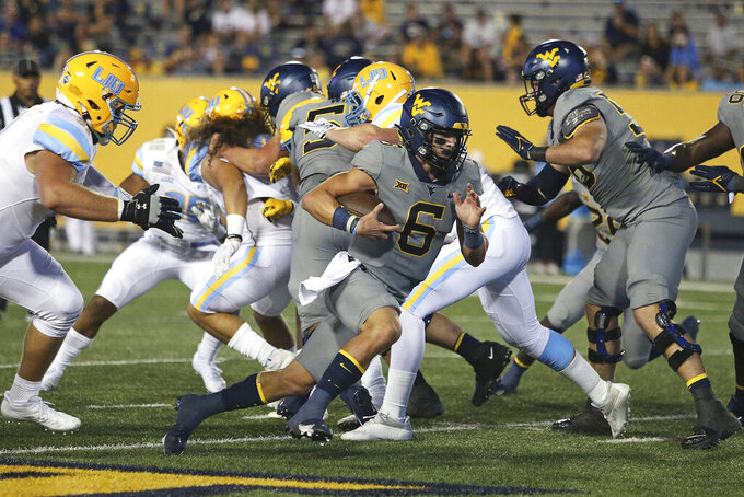 West Virginia quarterback Garrett Greene (6) runs against Long Island during the second half of an NCAA college football game in Morgantown, W.Va., Saturday, Sept., 11, 2021. (AP Photo/Kathleen Batten)