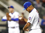 New York Mets relief pitcher Jeurys Familia reacts after walking in the go-ahead run of a baseball game against the Washington Nationals, Monday, April 16, 2018, in New York. (AP Photo/Kathy Willens)