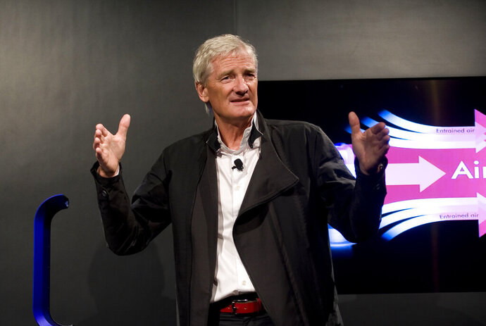 "FILE - In this Wednesday, Sept. 14, 2011 file photo, Inventor James Dyson launches the Dyson DC41 Ball vacuum and the Dyson Hot heater fan on in New York. Dyson, the British company best known for groundbreaking vacuum cleaners, is scrapping its electric car project because it doesn't make business sense. Billionaire founder James Dyson said in an email to employees on Thursday, Oct. 10, 2019 that it was shut down because the company ""simply can no longer see a way to make it commercially viable."" (AP Photo/Rob Bennett, file)"