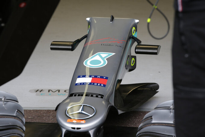 "A part of Mercedes driver Lewis Hamilton of Britain car with German that reads, ""Thanks Niki,"" stands on the Mercedes garage during the first practice session at the Monaco racetrack, in Monaco, Thursday, May 23, 2019. Three-time Formula One world champion Niki Lauda, who won two of his titles after a horrific crash that left him with serious burns and went on to become a prominent figure in the aviation industry, has died on May 21, 2109. He was 70. (AP Photo/Luca Bruno)"