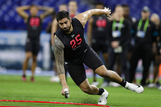 Iowa defensive lineman A.J. Epenesa runs a drill at the NFL football scouting combine in Indianapolis, Saturday, Feb. 29, 2020. (AP Photo/Michael Conroy)