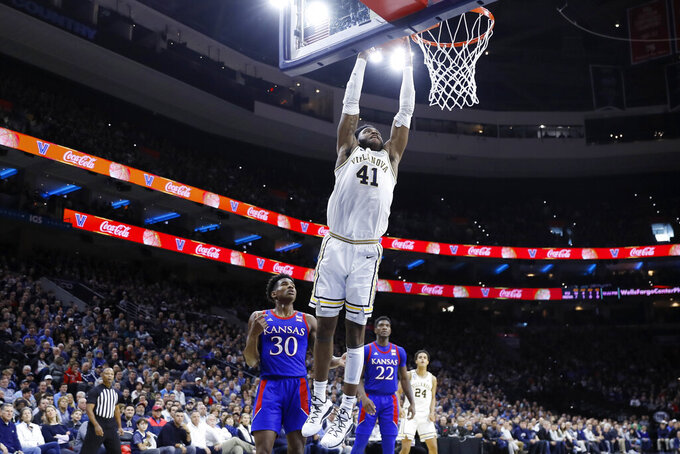 Villanova's Saddiq Bey (41) goes up for a dunk past Kansas's Ochai Agbaji (30) during the first half of an NCAA college basketball game, Saturday, Dec. 21, 2019, in Philadelphia. (AP Photo/Matt Slocum)