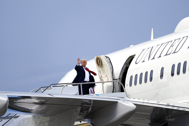 President Donald Trump waves as he leaves at West Palm Beach International Airport, Tuesday, Sept. 8, 2020, in West Palm Beach, Fla. (AP Photo/Evan Vucci)