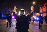 A demonstrator confronts a line of Oakland police officers during a protest against police brutality in Oakland, Calif., on Friday, April 16, 2021. (AP Photo/Ethan Swope)