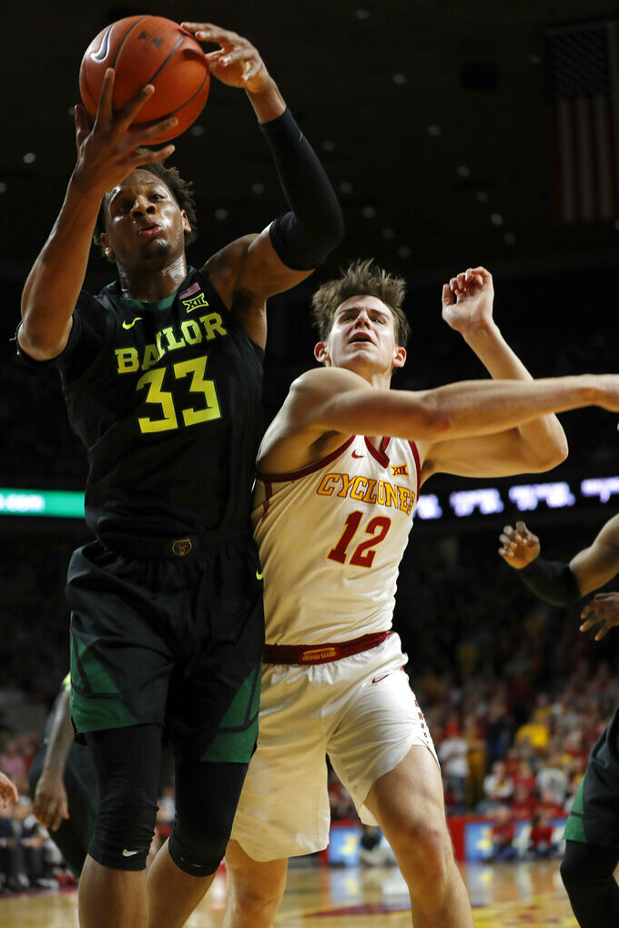 Baylor forward Freddie Gillespie, left, rips down a rebound in front of Iowa State forward Michael Jacobson, right, during the first half of an NCAA college basketball game, Tuesday, Feb. 19, 2019, in Ames, Iowa. (AP Photo/Matthew Putney)
