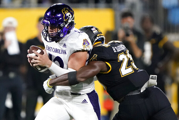 East Carolina quarterback Holton Ahlers is sacked by Appalachian State linebacker Brendan Harrington during the second half of an NCAA college football game Thursday, Sept. 2, 2021, in Charlotte, N.C. (AP Photo/Chris Carlson)