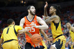 Illinois' Giorgi Bezhanishvili (15) has the ball knocked away by Missouri's Xavier Pinson (1) as Missouri's Mitchell Smith defends during the first half of an NCAA college basketball game Saturday, Dec. 21, 2019, in St. Louis. (AP Photo/Jeff Roberson)