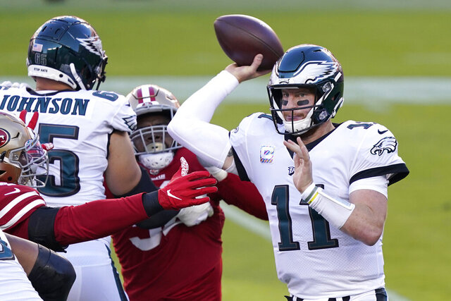 Philadelphia Eagles quarterback Carson Wentz (11) passes against the San Francisco 49ers during the first half of an NFL football game in Santa Clara, Calif., Sunday, Oct. 4, 2020. (AP Photo/Tony Avelar)