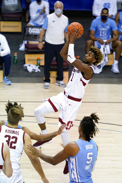 Stanford guard Daejon Davis (1) leaps to the basket past North Carolina forward Armando Bacot (5) in the first half of an NCAA college basketball game in the semifinals of the Maui Invitational tournament, Tuesday, Dec. 1, 2020, in Asheville, N.C. (AP Photo/Kathy Kmonicek)