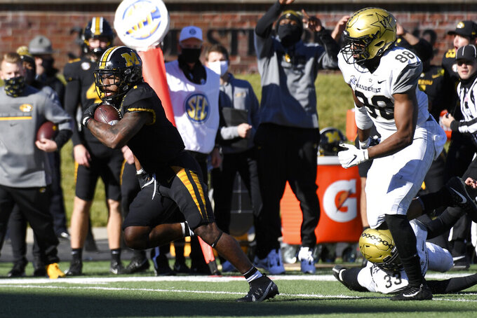 CORRECTS TO UPON REVIEW HE DID NOT SCORE-Missouri running back Tyler Badie, left, runs past Vanderbilt linebacker Michael Owusu (88) defends during the first half of an NCAA college football game Saturday, Nov. 28, 2020, in Columbia, Mo. (AP Photo/L.G. Patterson)