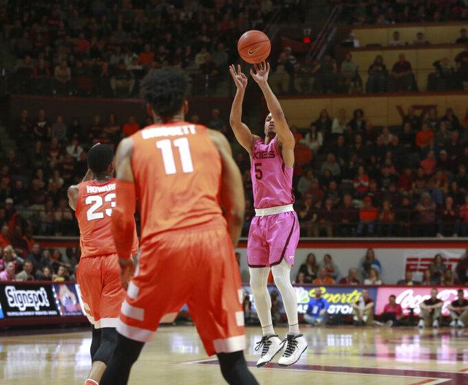 Virginia Tech's Justin Robinson (5) shoots one of seven first-half 3-point baskets against Syracuse during an NCAA college basketball game in Blacksburg, Va., Saturday, Jan. 26, 2019. (Matt Gentry/The Roanoke Times via AP)