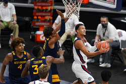 Gonzaga's Jalen Suggs (1) shoots next to West Virginia's Emmitt Matthews Jr. (11) during the first half of an NCAA college basketball game Wednesday, Dec. 2, 2020, in Indianapolis. (AP Photo/Darron Cummings)