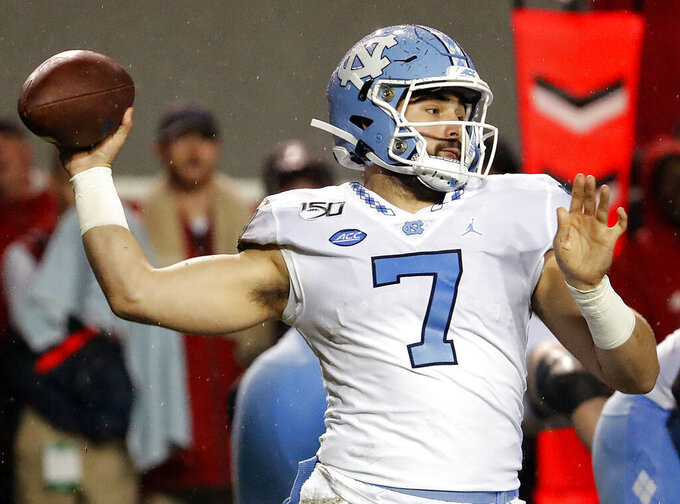 FILE - In this Nov. 30, 2019, file photo, North Carolina quarterback Sam Howell (7) passes the ball against North Carolina State during the first half of an NCAA college football game in Raleigh, N.C. The Tar Heels are No. 18 to start the season and have 10 returning starters back on offense. (AP Photo/Karl B DeBlaker, File)