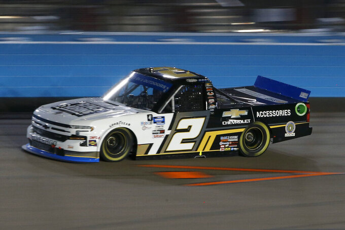 Sheldon Creed races through Turn 4 during the NASCAR Truck Series auto race at Phoenix Raceway, Friday, Nov. 6, 2020, in Avondale, Ariz. Creed won the race and the season championship. (AP Photo/Ralph Freso)