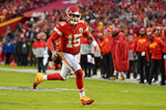 Kansas City Chiefs quarterback Patrick Mahomes (15) runs for a touchdown during the first half of an NFL football game against the Oakland Raiders in Kansas City, Mo., Sunday, Dec. 1, 2019. (AP Photo/Ed Zurga)
