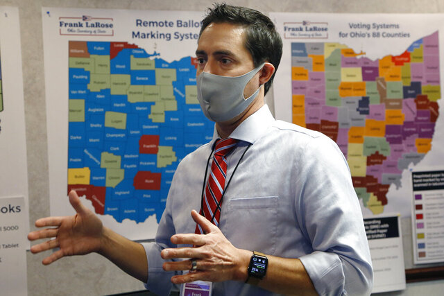 Ohio Secretary of State Frank LaRose interacts with staff members as they follow the election from Ohio's election command center Tuesday, Nov. 3, 2020, in Columbus, Ohio. (AP Photo/Jay LaPrete)