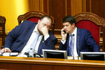 A newly elected parliament speaker Dmytro Razumkov, right, and first vice speaker Russian Stefanchuk attend a parliament session in Kyiv, Ukraine, Thursday, Aug. 29, 2019. Parliament in Ukraine has opened for its first session since an election last month. (AP Photo/Efrem Lukatsky)