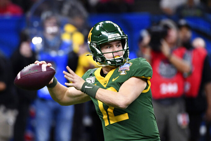 FILE - Baylor quarterback Charlie Brewer (12) passes in the first half of the Sugar Bowl NCAA college football game in New Orleans, Wednesday, Jan. 1, 2020. Brewer and Baylor took the Sooners to overtime in last year's title game, though the tough-minded quarterback didn't play after halftime following a hard hit he delivered on a defender on a running play before taking a hard sack. (AP Photo/Bill Feig, File)