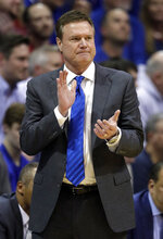 Kansas head coach Bill Self applauds his team during the second half of an NCAA college basketball game against Kansas State in Lawrence, Kan., Monday, Feb. 25, 2019. (AP Photo/Orlin Wagner)