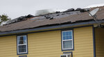 The roof of the Solar's Apartments in Morgan City, La., is damaged by the winds of Tropical Storm Barry, Saturday, July 13, 2019.  Nearly all businesses in Morgan City were shuttered as coastal Louisiana braced for the arrival of Tropical Storm Barry.  (AP Photo/Rogelio V. Solis)