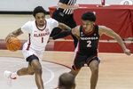 Alabama forward Herbert Jones (1) moves the ball down the floor with Georgia guard Sahvir Wheeler (2) defending during the second half of an NCAA college basketball game on Saturday, Feb. 13, 2021, in Tuscaloosa, Ala. (AP Photo/Vasha Hunt)