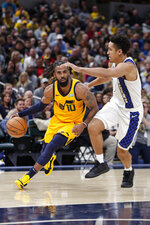 Utah Jazz guard Mike Conley (10) drives on Indiana Pacers guard Malcolm Brogdon (7) during the second half of an NBA basketball game in Indianapolis, Wednesday, Nov. 27, 2019. The Pacers won 121-102. (AP Photo/Michael Conroy)