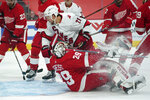 Carolina Hurricanes right wing Nino Niederreiter (21) scores on Detroit Red Wings goaltender Thomas Greiss (29) in the first period of an NHL hockey game Thursday, Jan. 14, 2021, in Detroit. (AP Photo/Paul Sancya)