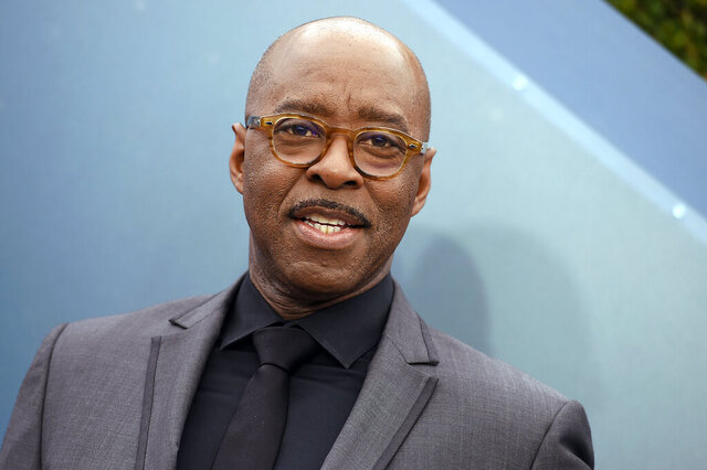 """FILE - In this Jan. 19, 2020, file photo, Courtney B. Vance arrives at the 26th annual Screen Actors Guild Awards at the Shrine Auditorium & Expo Hall in Los Angeles. Netflix is canceling its South by Southwest screenings and events amid concerns about the outbreak of the new coronavirus. A company spokesperson confirmed to the Associated Press on Wednesday, March 4, 2020, that the streamer is pulling out of the annual Austin-based festival, which kicks off next week. The company had planned to screen the feature film """"Uncorked,"""" with Vance, and four docuseries. (Photo by Jordan Strauss/Invision/AP, File)"""