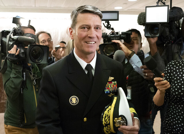 FILE - In this April 24, 2018 file photo, Ronny Jackson leaves a Senate office building on Capitol Hill in Washington. Jackson, President Donald Trump's former White House physician and onetime pick to head the Department of Veterans Affairs, won the Republican nomination for a U.S. House seat in Texas on Tuesday, July 14, 2020, in an election that unfolded amid an alarming spread of the coronavirus.  The retired Navy rear admiral defeated agriculture advocate Josh Winegarner in a primary runoff in the deeply red Texas Panhandle. Jackson will face Gus Trujillo, who won Tuesday's Democratic nomination for the 13th congressional district in Texas, in the November general election. (AP Photo/J. Scott Applewhite, File)