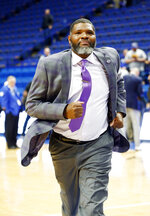 Evansville coach Walter McCartey runs off the court after Evansville defeated Kentucky 67-64 in an NCAA college basketball game in Lexington, Ky., Tuesday, Nov. 12, 2019. (AP Photo/James Crisp)