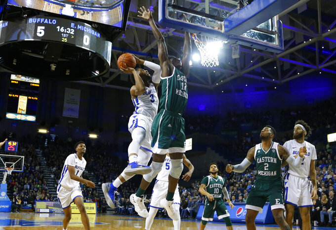 Buffalo guard jayvon Graves (3) is defended by Eastern Michigan center Boubacar Youre (12) during the first half of an NCAA college basketball game, Friday, Jan. 18, 2019, in Buffalo N.Y. (AP Photo/Jeffrey T. Barnes)