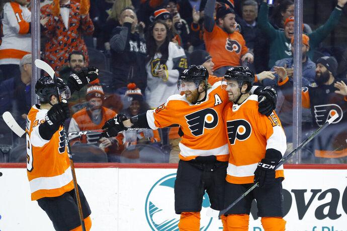 Philadelphia Flyers' Jakub Voracek, center, celebrates with Matt Niskanen, right, and Joel Farabee after scoring a goal during the second period of an NHL hockey game against the Pittsburgh Penguins, Tuesday, Jan. 21, 2020, in Philadelphia. (AP Photo/Matt Slocum)