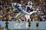 North Carolina's Myles Dorn (1) celebrates a big stop with teammate Patrice Rene (5) during the first quarter of the team's NCAA college football game against Miami in Chapel Hill, N.C., Saturday, Sept. 7, 2019. (AP Photo/Chris Seward)