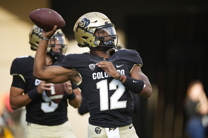 Colorado quarterback Brendon Lewis warms up before an NCAA college football game against Northern Colorado, Friday, Sept. 3, 2021, in Boulder, Colo. (AP Photo/David Zalubowski)